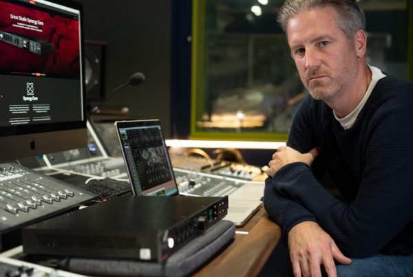 Producer Jason O'Bryan sitting in front of a laptop